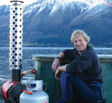 image - Kiwitub creator Steve August leans up against one of his prototype tubs, on the shores of lake Wanaka.
