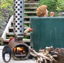 image - a wood fired burner heats a this Kiwitub being enjoyed in a garden.